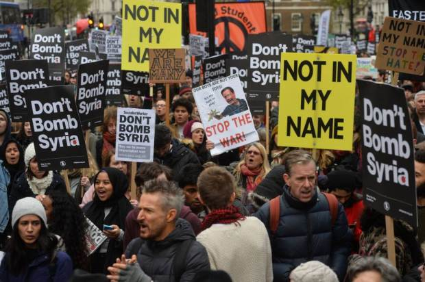 Protesters at Whitehall in London, during a demonstration organised by Stop the War Coalition against proposed bombing of the Islamic State in Syria. PRESS ASSOCIATION Photo. Picture date: Saturday November 28, 2015. See PA story POLITICS Syria Protest. Photo credit should read: Hannah McKay/PA Wire