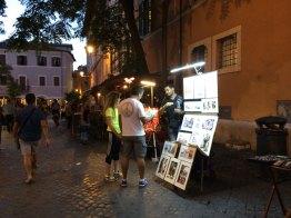 Puestos de artesanía y pintura en el Trastevere
