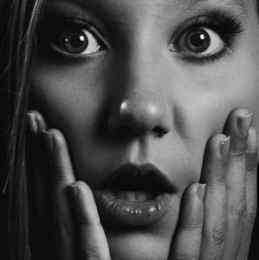grayscale portrait photo of shocked woman