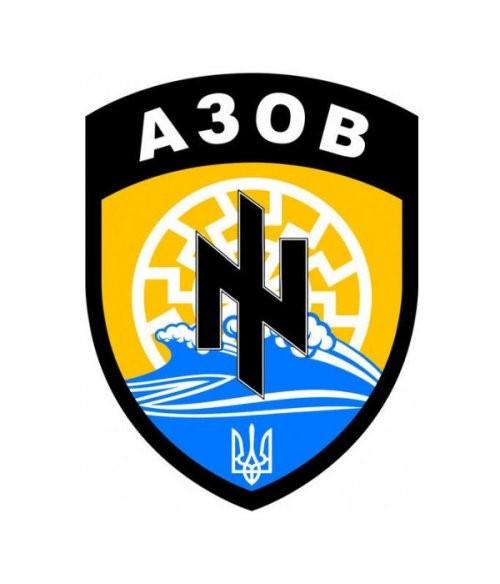Le symbole du bataillon ukrainien Azov, en arrière-plan, le « soleil noir »… d39fdb82199