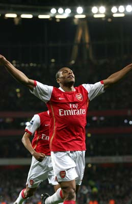 Baptista celebrates his goal against Manchester City