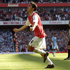 Cesc Fabregas celebrates his goal against Manchester City