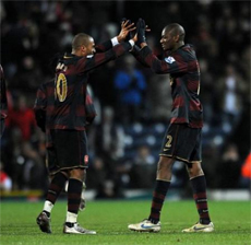 Traore and Diaby celebrate at the whistle