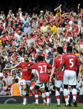 Cesc celebrates his goal with Eboue and Co