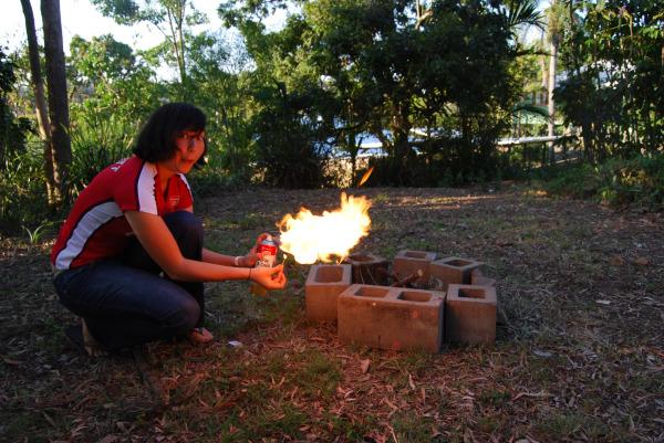 Annie prepares the fire
