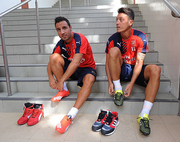 Santi-cazorla-and-mesut-ozil-of-arsenal-before-a-training-session-at-picture-id480634584