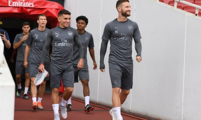 Arsenal players entering the pitch