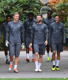 Arsenal players arrive for training