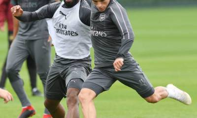 Lacazette and Torreira in training
