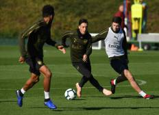 ST ALBANS, ENGLAND - OCTOBER 21: Mesut Ozil and Charlie Gilmour of Arsenal during the Arsenal Training Session at London Colney on October 21, 2018 in St Albans, England. (Photo by David Price/Arsenal FC via Getty Images) *** Local Caption *** Mesut Ozil; Oezil; Charlie Gilmour