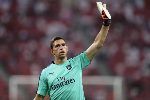 Emiliano-martinez-of-arsenal-waves-his-hand-prior-to-the-champions-picture-id1006645442