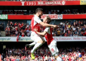 Olivier Giroud celebrates the opening goal of his hat-trick against Aston Villa