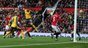Giroud snatches point for Arsenal with late headed goal