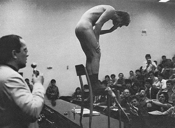 Günter Brus vomits during an unauthorized actionist performance of Art and Revolution at the University of Vienna, 1968.