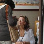 Elaine Frenett takes a moment to look at a shot in a visitor's camera