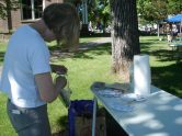 Anne Brooke sets up the art exploration tables for the kids.