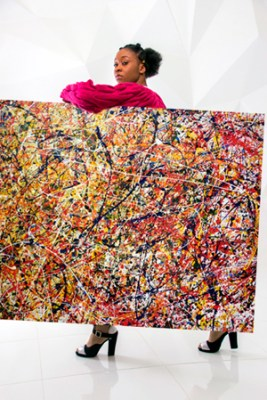 African fashion model with a jackson pollock painting
