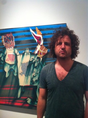 Painter Adam Scott with his work at the Elmhurst Art Museum