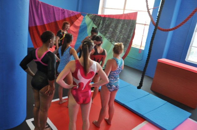 """Macon Reed and the gymnasts who performed """"Team Spirited"""" in her installation """"Physical Education."""" Photo by Mat Wilson"""