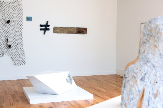 """installation view of avery r. young's """"Ballad of Twin lakes"""" and sculpture by Caroline Kent"""