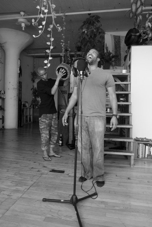 "Val Jeanty and Douglas Kearney rehearsing ""Freedom of Shadow: A Tribute to Terry Adkins"" at Jeanty's studio in Brooklyn. Photo by zkonqü."