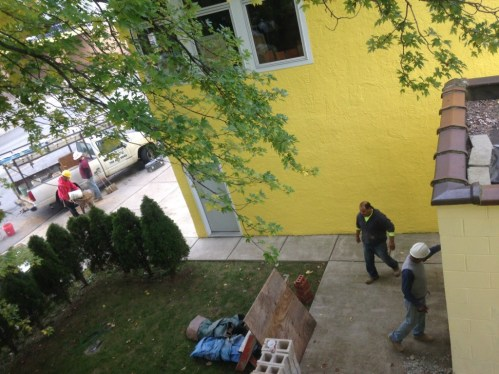 Contractors beginning work on the Suburban's repairs on October 13
