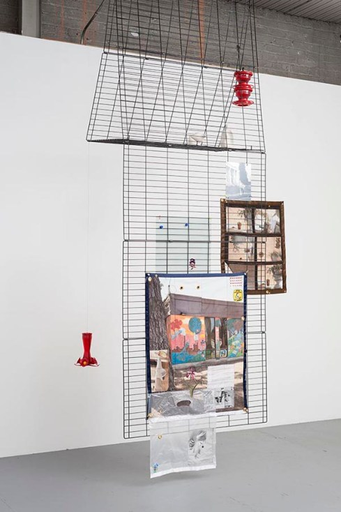 "Erin Jane Nelson. ""Premium 8 Panel Exercise Pen,"" 2015 dog playpen, hummingbird feeders, porcelain bottles, quilt, aluminum prints, carabineers"