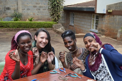 Women from the Maisha Collective pose with their new jewelry designs made with Chicago designer Lagi Nadeau