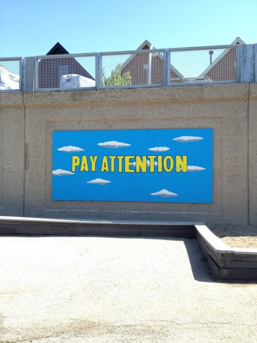 """Pay Attention"" wall mural by Project Onward artist Louis DeMarco, installed along the 606 trail."