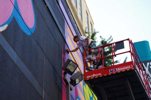 Ben Eine working on his mural at South Wabash.