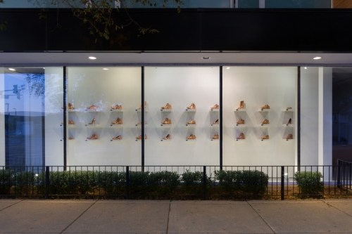 """Kendell Carter. """"WE,"""" 2012-2015. Bronze-plated shoes, aluminum dog tags, laminate shelves, installation dimensions variable. /Photo: """"on the wall"""" at moniquemeloche."""