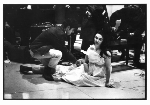 "Peter Moore. Charlotte Moorman performs Yoko Ono's ""Cut Piece,"" New York University, New York City, December 16, 1967. Photograph © Barbara Moore/Licensed by VAGA, NY."