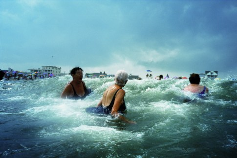 Amy Toensing, Longtime Ocean Grove visitors take a dip in the roiling Atlantic surf. Women of Vision, Forest Lawn. Photo courtesy National Geographic Society.