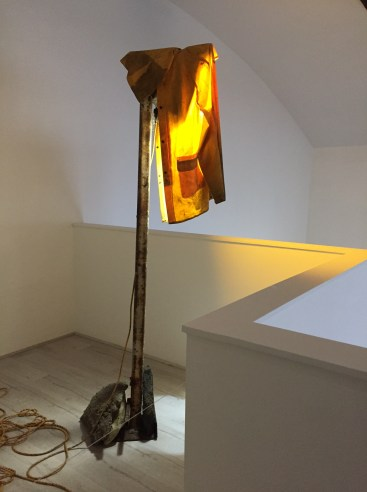 Sun Valley Shroud. Iron, raincoat, LED lamp, stones, cement, cord, string. 2017. Ohlsson/Dit-Cilinn: HYDROGENESIS. HILDE L.A., Mid-City. Photo Credit Shana Nys Dambrot.