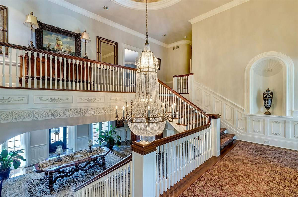 A classic wood and white baluster staircase, but on a grander scale.