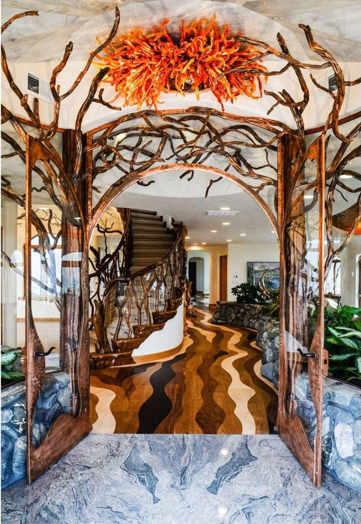 Continue into this unique home and the shoreline ends at custom-designed and intricately laid hardwood floor that appears to flow like water.