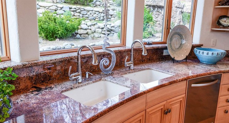 Even the kitchen counter-tops were custom crafted to maintain the flowing curves of the rest of the house.