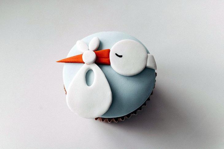 Stork Delivering a Baby Cupcake