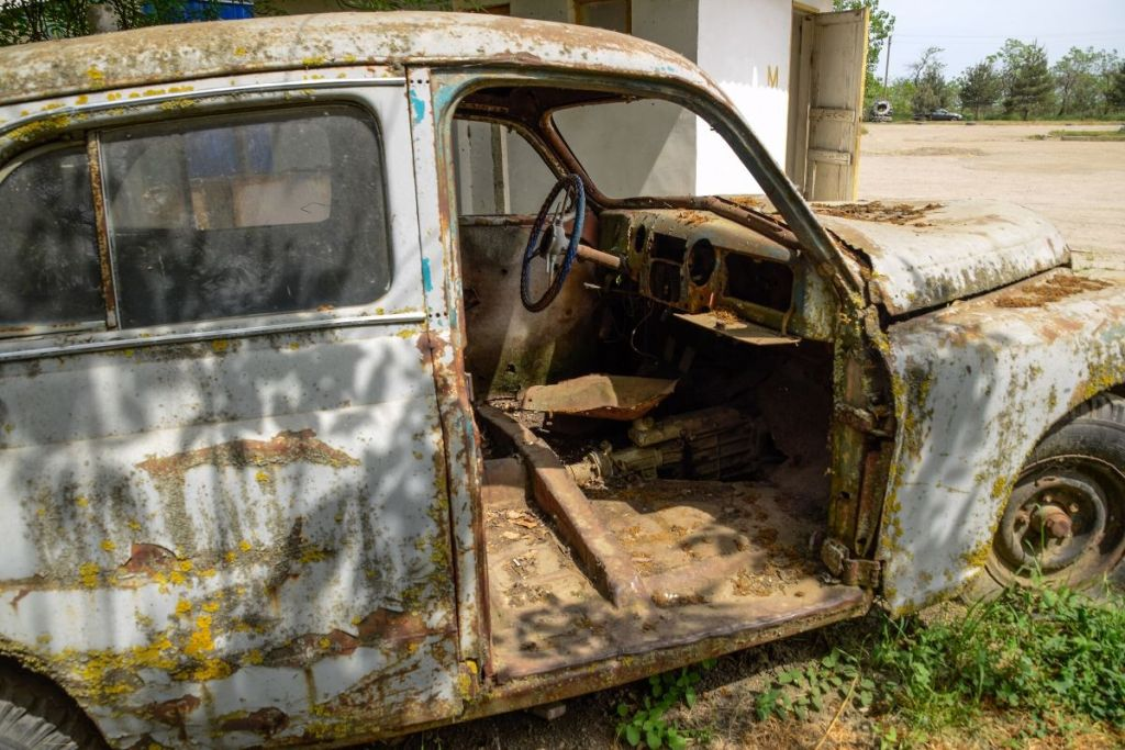 Decaying Abandoned Car with Interior View