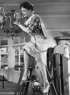 Mildred Pierce Cleaning Her Chandelier