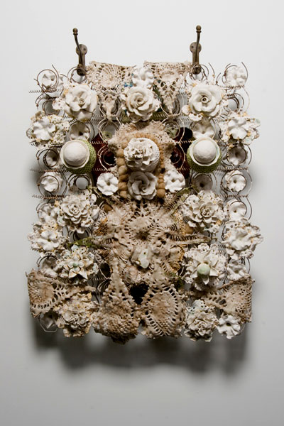 porcelain, slip-fired and unfired doilies, wax and sand, bedsprings, fabric, hair, antique
