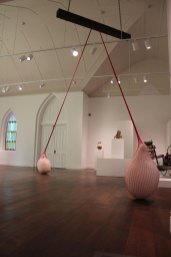 """2014, coil-built earthenware, terra sigillata, hand knit and dyed cotton net, wood, steel, dimensions vary: ceiling height: 18', forms: approx. 30 X 20"""", Installed at Foothills Art Center, Golden, CO."""