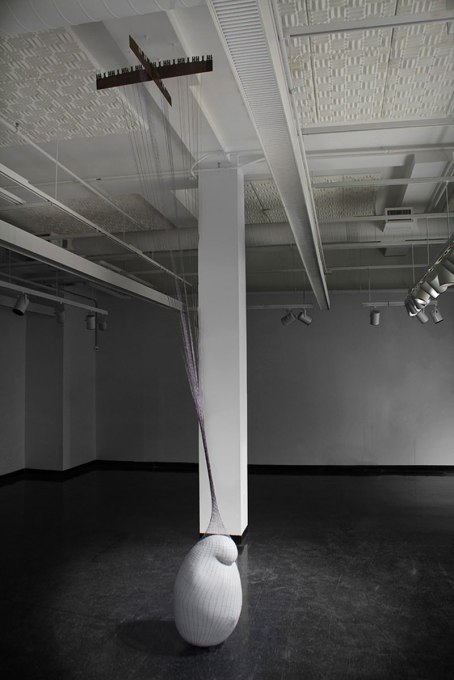 """2012, coil-built earthenware, terra sigillata, hand knit and dyed cotton net, steel saw blade, form: approx. 30 X 20"""", ceiling height: 14', Installed at UMASS Dartmouth Star Store, New Bedford, MA."""