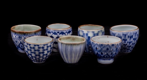 This work features celadon glaze and Kiangxi quinhua - Jingdezhen under-glaze blue and white - and 24 k Roman gold. These pieces utilize a runny celadon glaze gas reduction fired, and re-firing at low temperature for gold and enamel applications. Gold nuggets are stoneware clay fragments with gold applications.