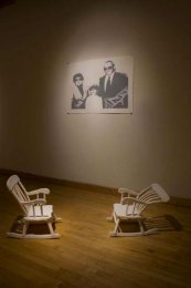 "Installation at Fleisher, press molded porcelain rocking chairs, three color screen print, 48"" x 25"", 2009"