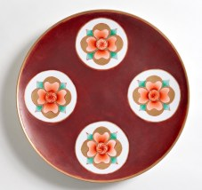This plate features over-glaze enamels - fahong red, youhong red, fencai - and 24k gold. After reduction firing the piece was hand-painted and re-fired in multiple firing to layer on media. Original flower signifies intrinsic goodness, externally and internally.