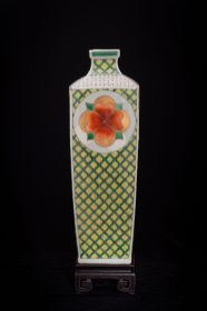Vase with Flower Medallions was press-molded and fired cone 10 reduction. Traditional gucai over-glaze media and 24k German gold was hand-painted in layered applications and re-fired in multiple electric low temperature firings (6 firings). The work features the luminosity inherent to the media to render a sensual stately but joyful enriching presence.
