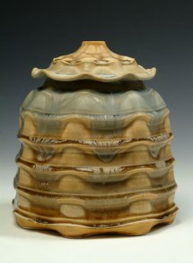 "Porcelain, wheel thrown and wet altered, Cone 10, oxidation fired, H: 12"" x D: 10""