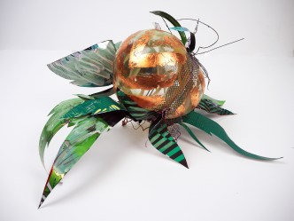 Hand blown glass with copper leaf and repurposed aluminum and plastic that has been hand painted.