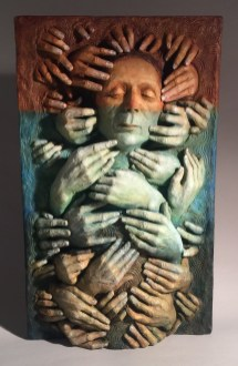 Collective Unconscious, a large scale relief, from the series HandWork, explores the way our point of view is influenced in the subconscious. Many hands represent the variety of ways we are moved by many others on a subconscious level. The colors range from an earthy brown for the physical and intellectual, transitioning to a watery blue as the emotional or heart level and a deeper black going into the depths of our being at the gut level. In Seven Obstacles the same care for metaphor and color will be applied.